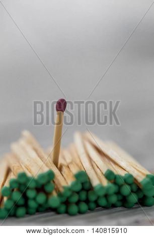 a lot of green matches and one red leadership light background fire