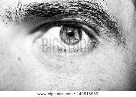 Image of man's eye close up. Monochrome