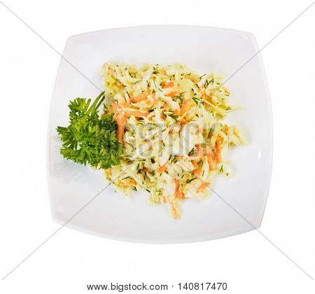 Dish of cabbage and carrot salad (coleslaw) top view over white