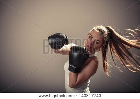 Energetic Young Woman Fight With Boxing Gloves.