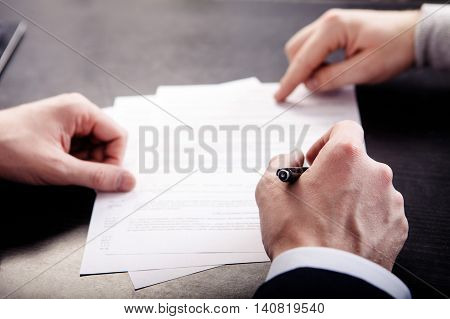 Business conflict, on business meeting manager and employee destroy draft of document. poster