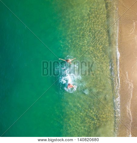 People on the beach by aerial view