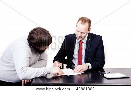 Two business people in elegant suits, chief looking precisely at employee, holding clipboard with papers isolated on white background.
