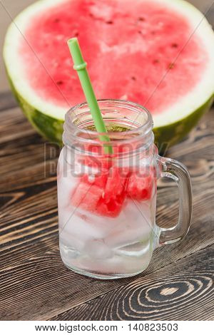 Watermelon Drink in Glass with Slices of Watermelon on Wooden Background. Healthy Food Concept