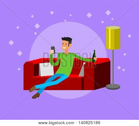 Man resting at home, laying on sofa and drinking beer, looking in smartphone