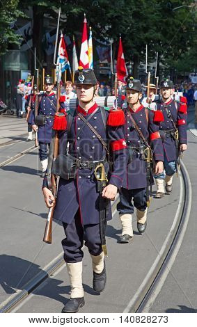 ZURICH - AUGUST 1: Swiss National Day parade on August 1, 2016 in Zurich, Switzerland. Representative of swiss army in a historical costume.