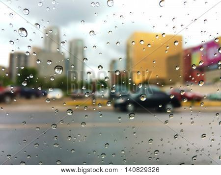 raindrops on car window in the city