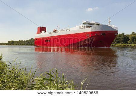 Huge car carrier on Kiel Canal heading to the baltic sea