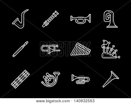 Brass musical instruments. Oboe and clarinet, bagpipes and saxophone, tuba and trombone and other samples. Set of flat white line vector icons on black background.