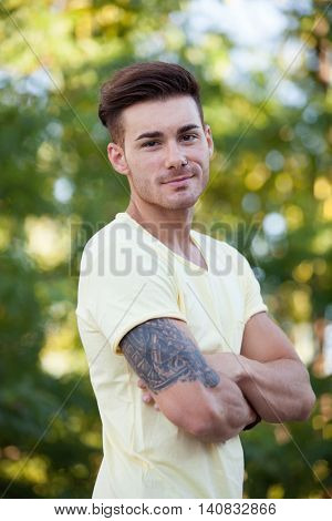 Attractive guy in the park with yellow t-shirt