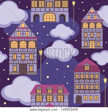 seamless pattern with the image of old town houses and clouds. night cityscape.
