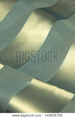 This is a photograph of a Blue Polyester fabric scarf with sheer insert