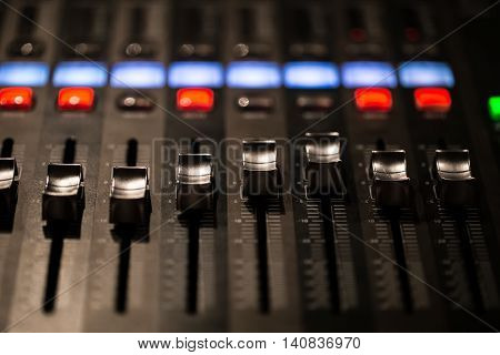 fader digital mixing console with volume meter volume indicator closeup