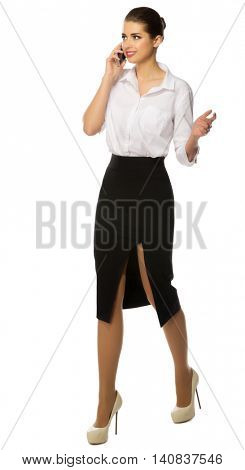 Young businesswoman with mobile phone isolated
