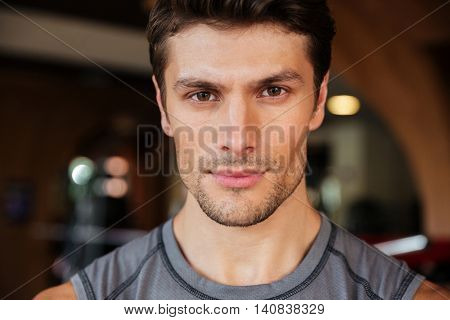 Closeup of handsome young fitness man in gym