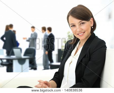 Beautiful business woman with co-wokers at background