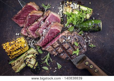 Barbecue Roast Beef with Vegetable on old Metal Sheet