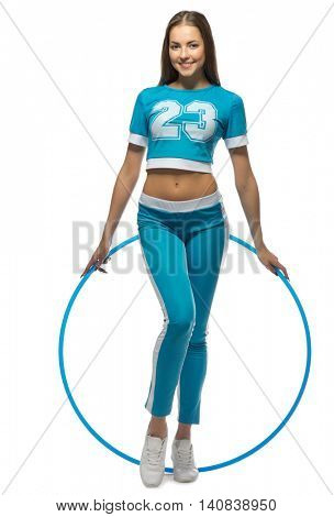 Young sporty woman with hoop isolated