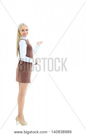 Happy young beautiful business woman showing blank area