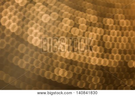 abstract blurred of golden colour backgrounds with circle lights.blur of bokeh circle light christmas festive backdrop concept:blur gold yellow backdrop concept.