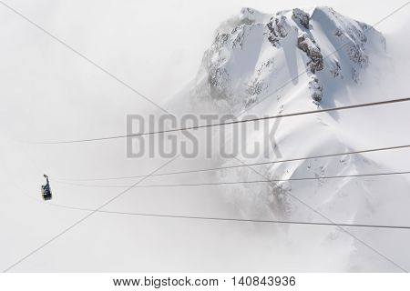 Dachstein rises above the clouds - in the foreground Gondola austria