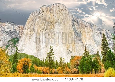 The Yosemite Valley monolith known as El Capitan. El Capitan is a vertical rock formation in Yosemite National Park located on the north side of Yosemite Valley near its western end.