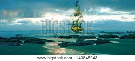 A merchant marine sail ship sailing dangerously close to rocks and the beach.