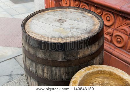 furniture and object concept - close up of old wooden barrel table at bar or pub outdoors
