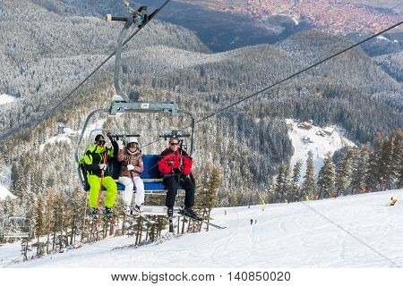 Bansko, Bulgaria - March 4, 2016: Ski resort Bansko, Bulgaria aerial view, skiers on lift,  people skiing on slopes