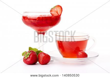 Dessert from ripe sweet berries of strawberries and cup of tea on a white background
