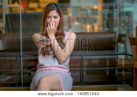 Young Girl Holding A Remote Control Watching Sad Movie
