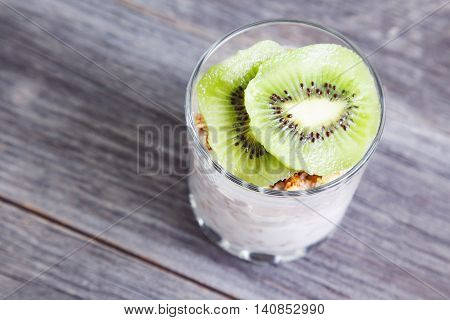 Healthy Layered Dessert With Cream, Muesli, On Wooden Background