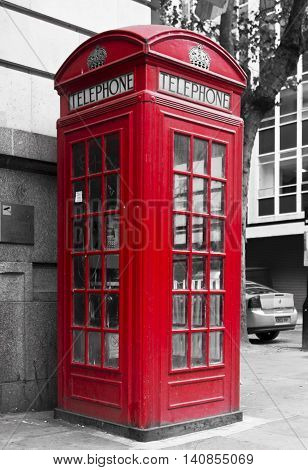 LONDON, UNITED KINGDOM - SEPTEMBER 12 2015: Traditional English Red phone box in the street