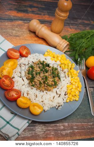 stew with rice and vegetables on wood background