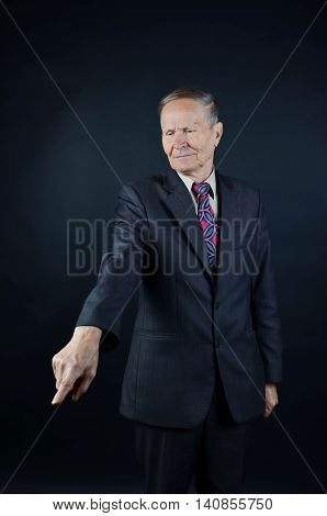 Man pointing at something isolated on black background