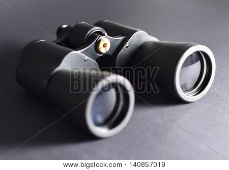 Binoculars, macro studio shot. Black binoculars with selective focus.