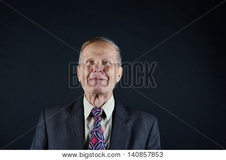 Business man with tongue out, lick lips, senior man closeup portrait isolated on black background. Emotions, facial expression and people concept