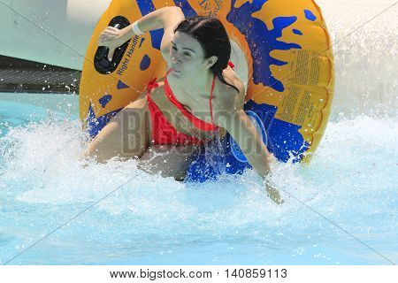 Rhodes Greece-July 29, 2016:The girl after rafting slide in the Water park.Rafting slide is one of many popular game for adults and children in park.Water Water Park is located on the island of Rhodes in Greece and one of the most larges