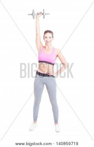 Woman At Gym Holding Up One Heavy Dumbbell