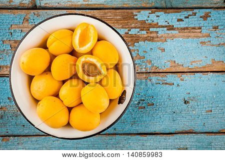Fresh Ripe Organic Apricots In Bowl Above View