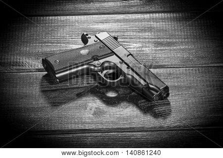 Airsoft gun replica on dark background poster