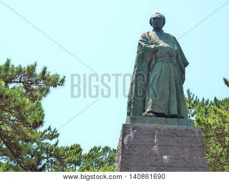 KOCHI, JAPAN - JULY 19, 2016: Statue of Sakamoto Ryoma stands on the hill near Katsurahama beach in Kochi, Japan. Sakamoto Ryoma is a prominent figure in Japan. He was born in Tosa (old name of Kochi).