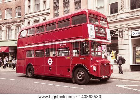 LONDON - JUL 02 2015: Vintage red double-decker bus in a street of London UK.