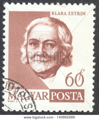 MOSCOW RUSSIA - CIRCA APRIL 2016: a post stamp printed in HUNGARY shows a portrait of Clara Zetkin circa 1960