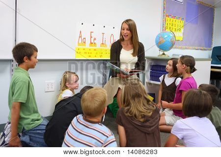 Elementary school teacher reads story to class