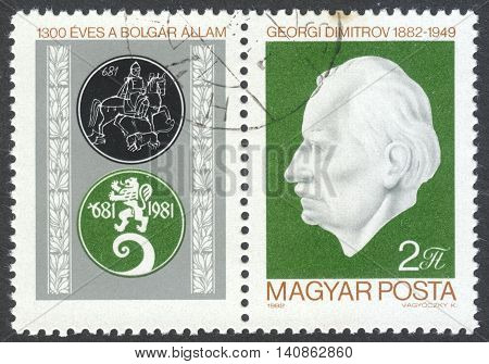 MOSCOW RUSSIA - CIRCA APRIL 2016: a post stamp printed in HUNGARY shows a portrait of G. Dimitrov dedicated to the International Stamp Exhibition SOZPHILEX `82 Veliko Tarnovo circa 1982