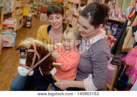 charming family spends time in toy shop