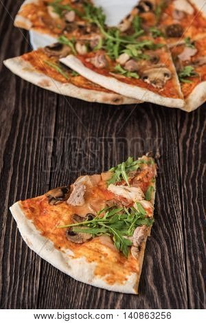Pizza with chicken mushrooms and rukkola