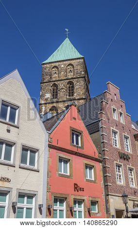 RHEINE, GERMANY - JULY 19, 2016: Colorful houses and church tower in the center of Rheine, Germany
