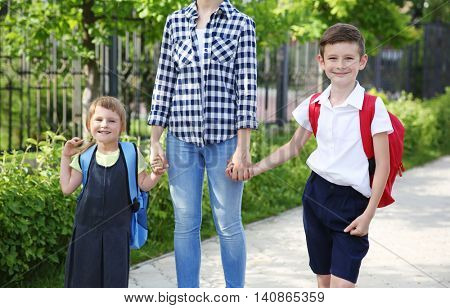 Mother taking children to school